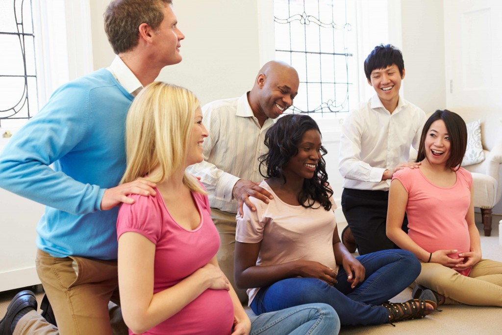 group of pregnant couples in birthing class