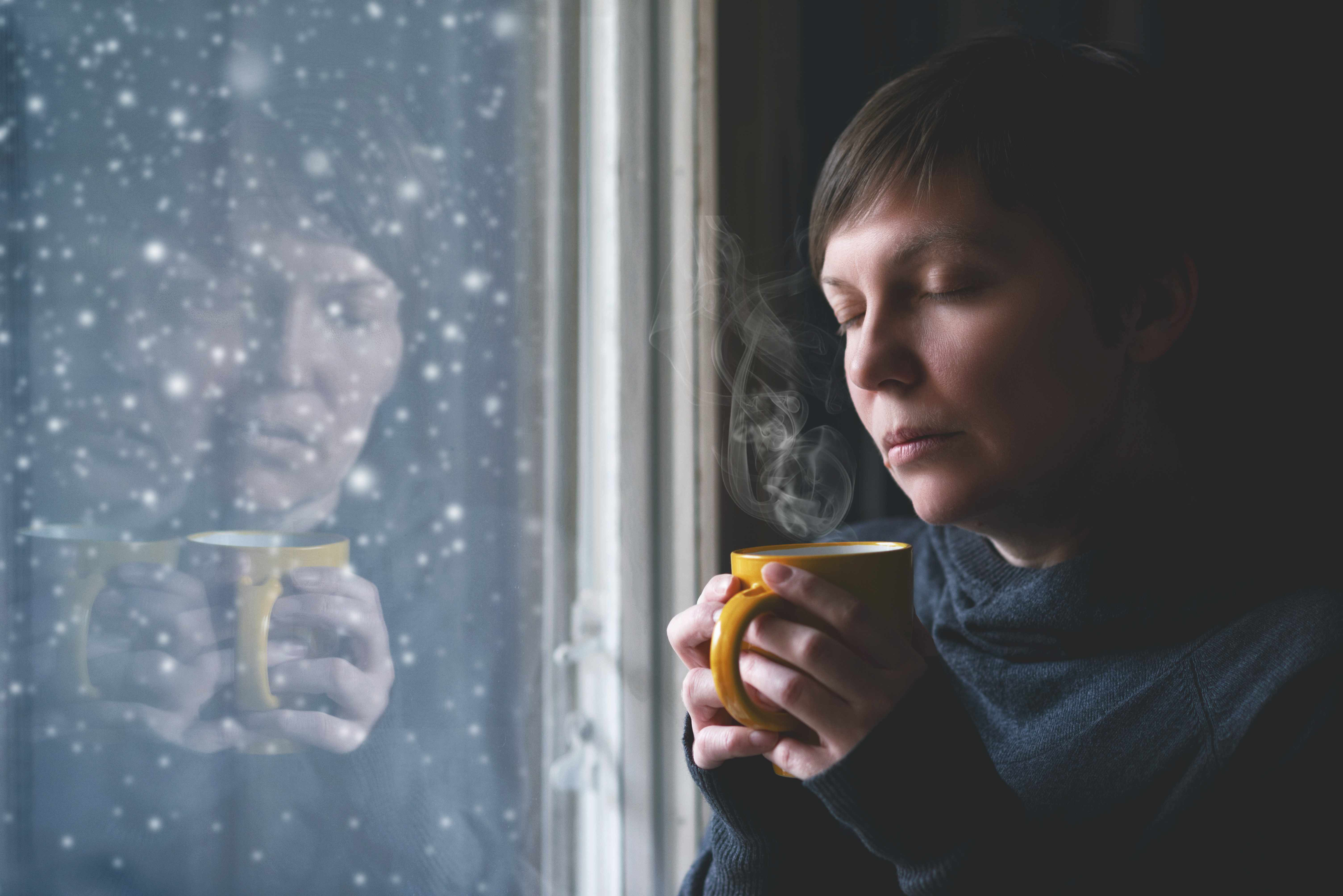 sad woman with depression, lonliness or seasonal affective disorder