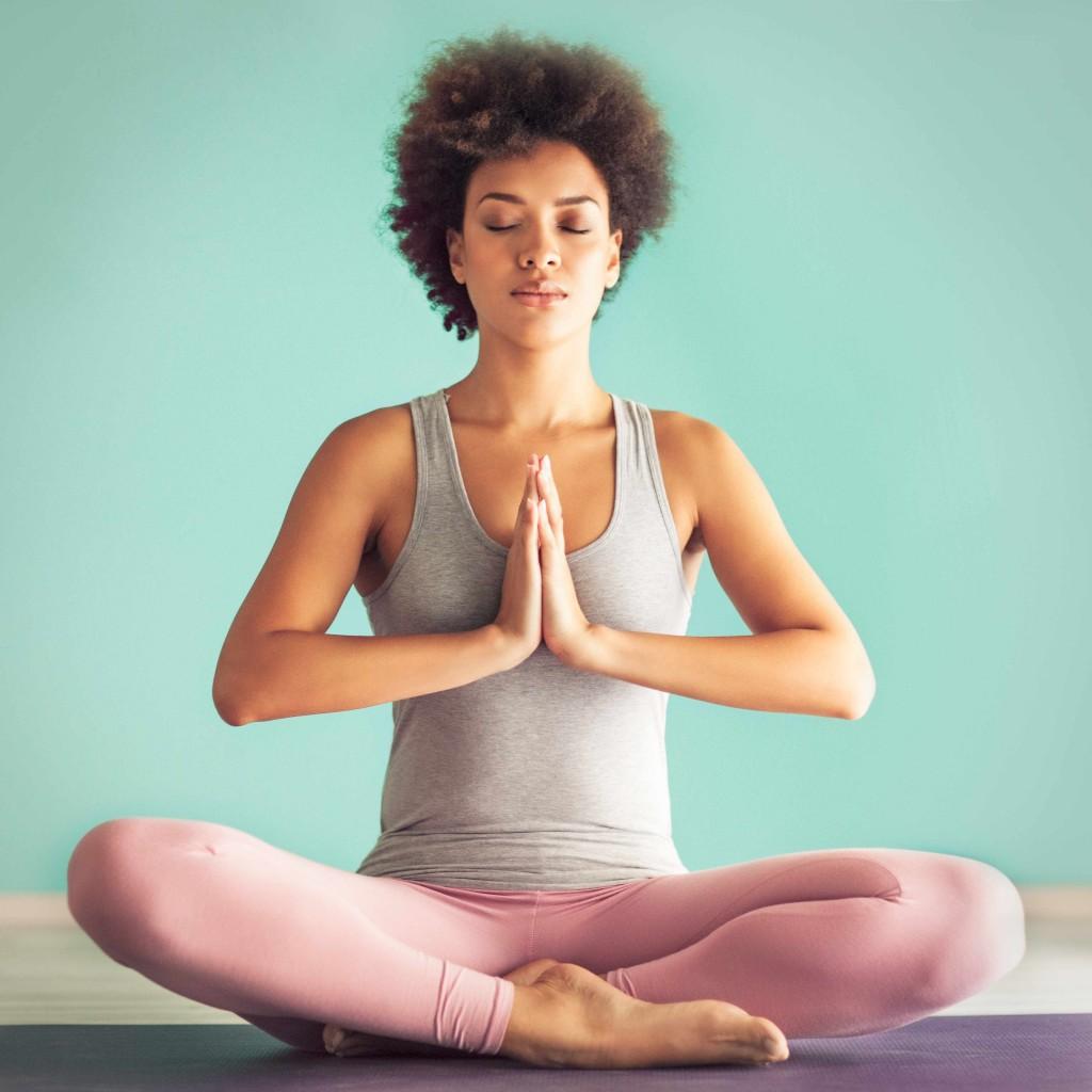 woman doing yoga, alternative medicine, meditating