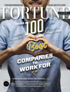 """Magazine cover with male hands creating a heart with his hands with the words """"Best Companies to Work For"""" on the cover."""