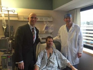 Iowa State Coach Fred Hoiberg in hospital bed after surgery