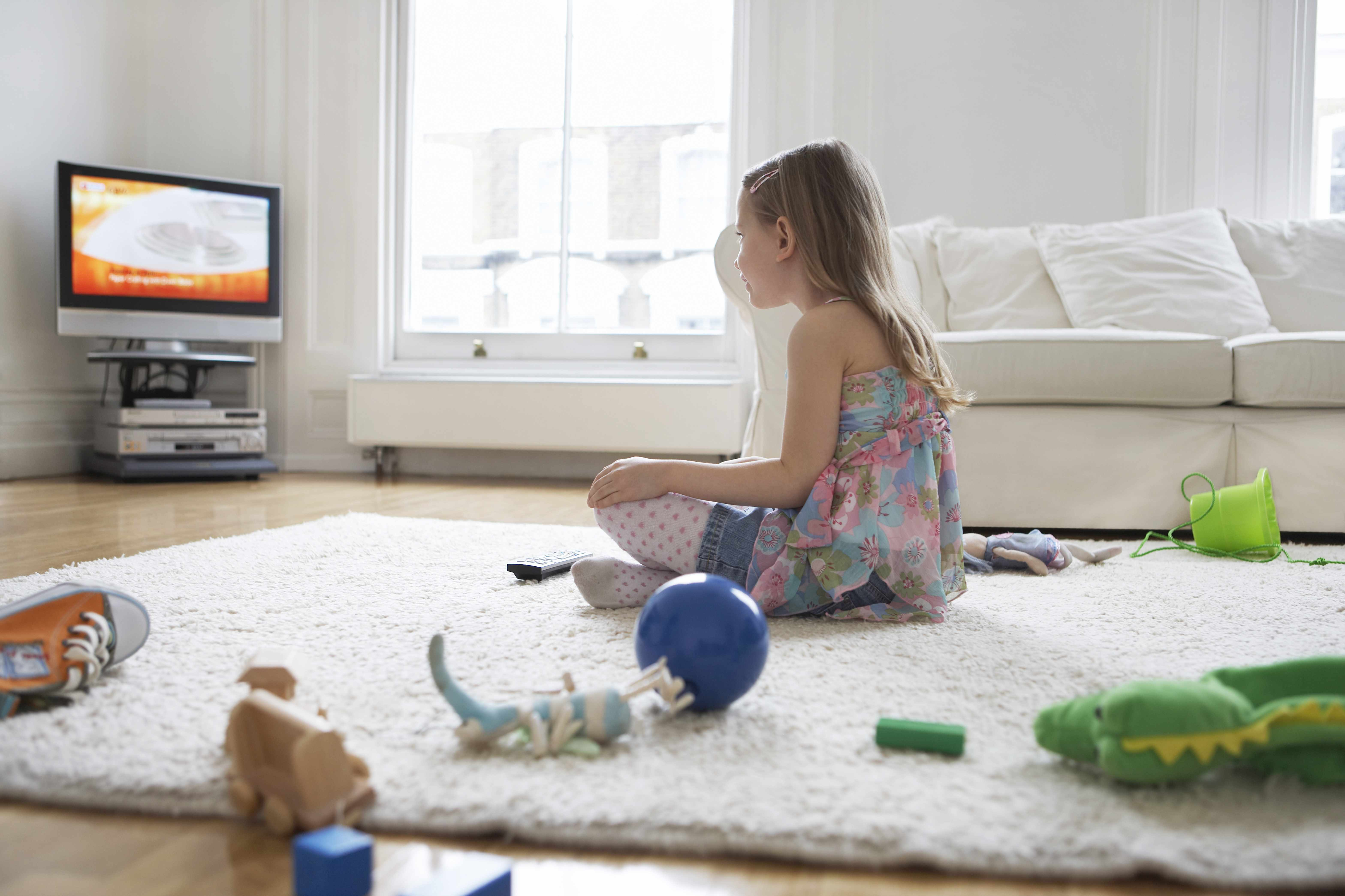 little girl staring at television screen, monitor