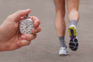 runner being timed by person holding a stopwatch