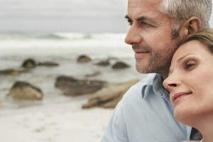 middle aged man and woman on beach, romantic