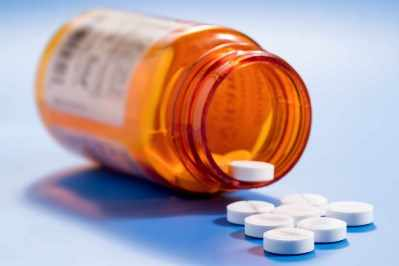 Un frasco con analgésicos