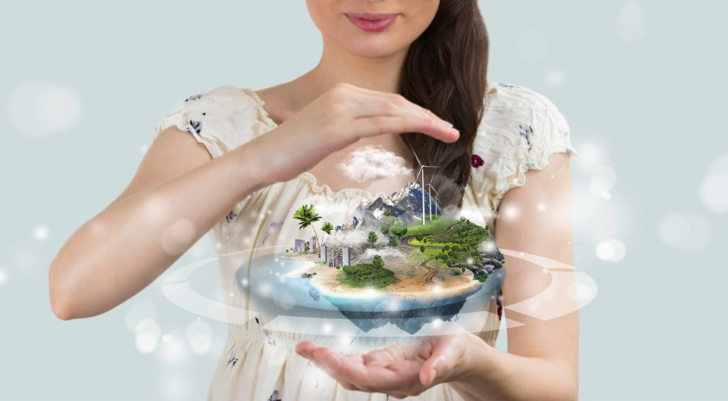 woman holding clear glass globe representing a perfect world