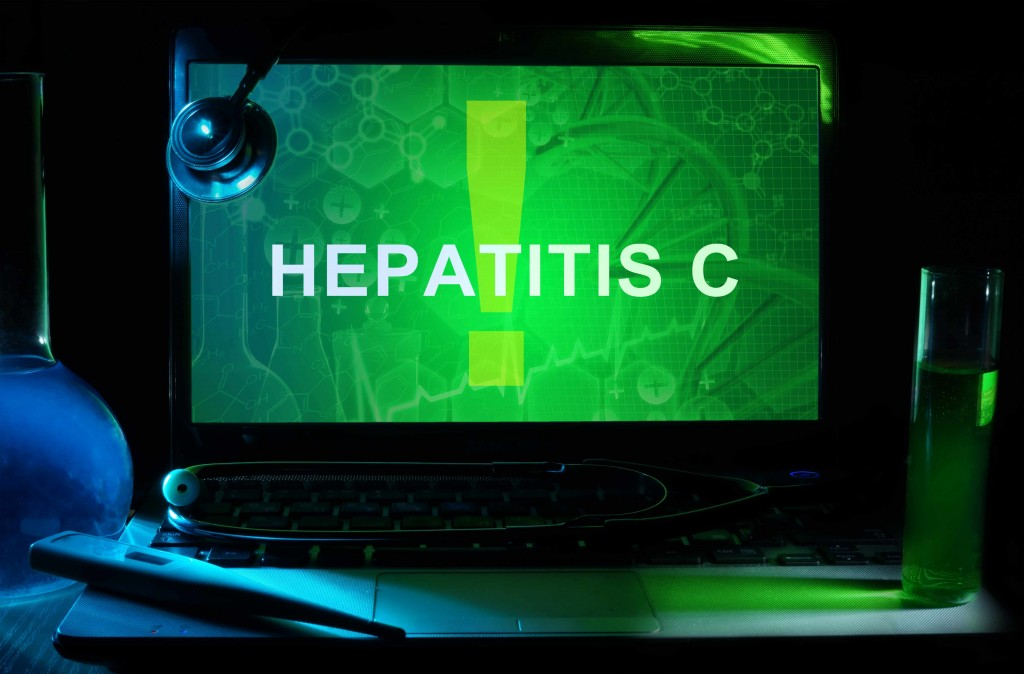 computer monitor screen with the sign Hepatitis C