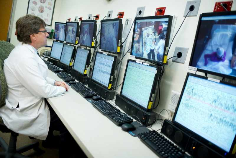 neurology researcher studying monitors with epilepsy patients