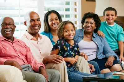 multigenerational African American family sitting on couch