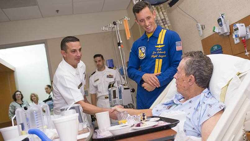 Blue Angels pilots visits patient in hospital bed
