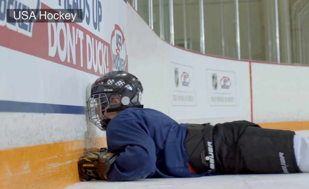 hockey player falling on the ice