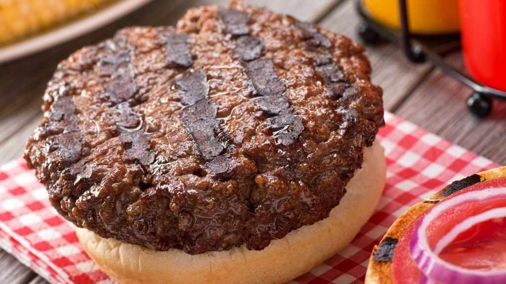 cooked hamburger patty on a bun