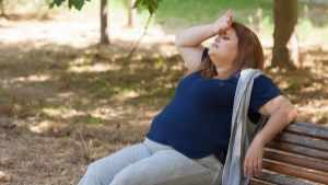 overweight woman sitting on a bench