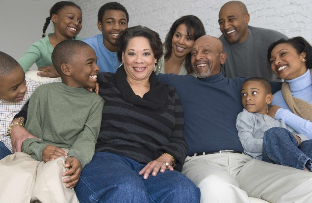 multi generational African American family sitting on a couch