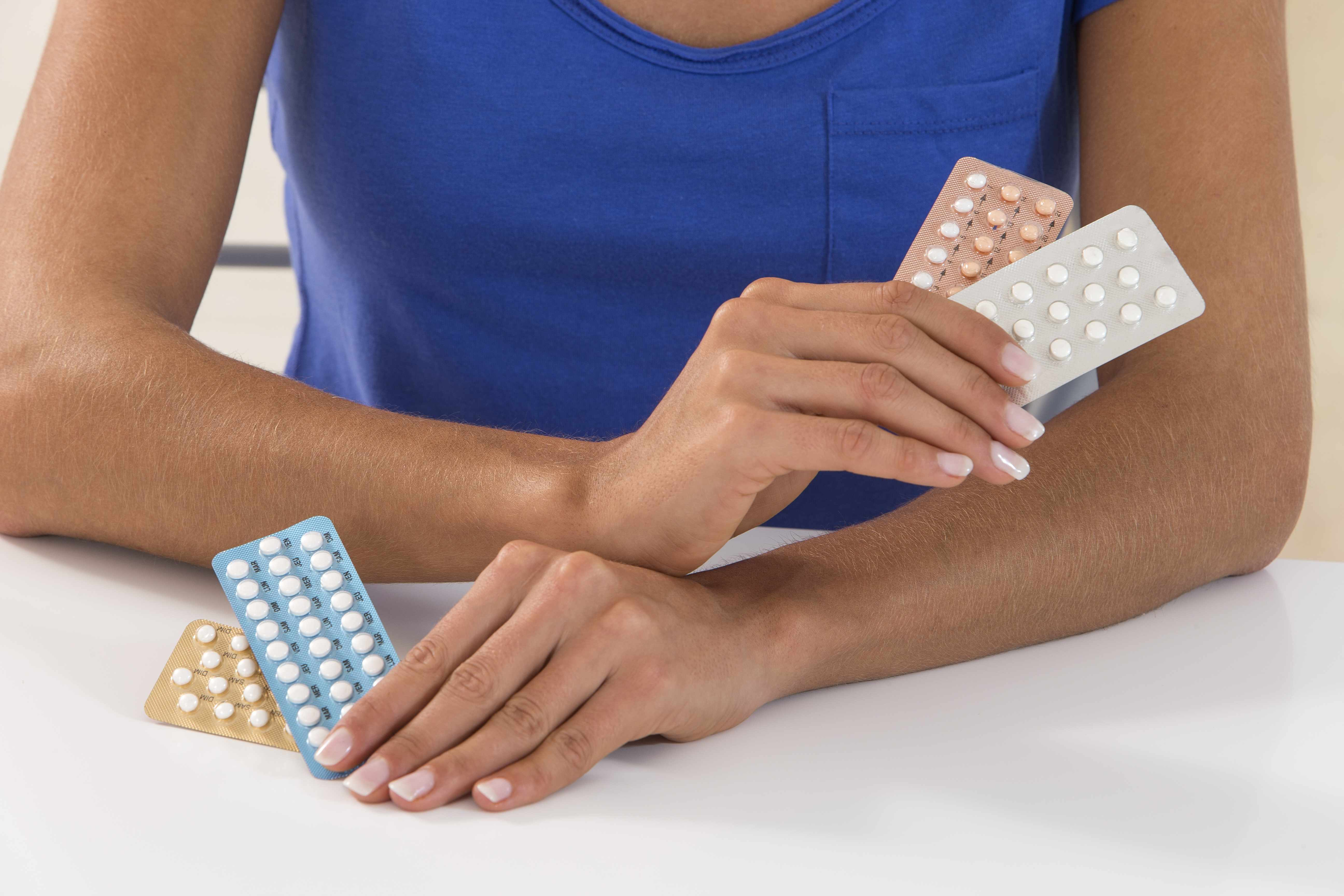 woman holding packet of birth control pills