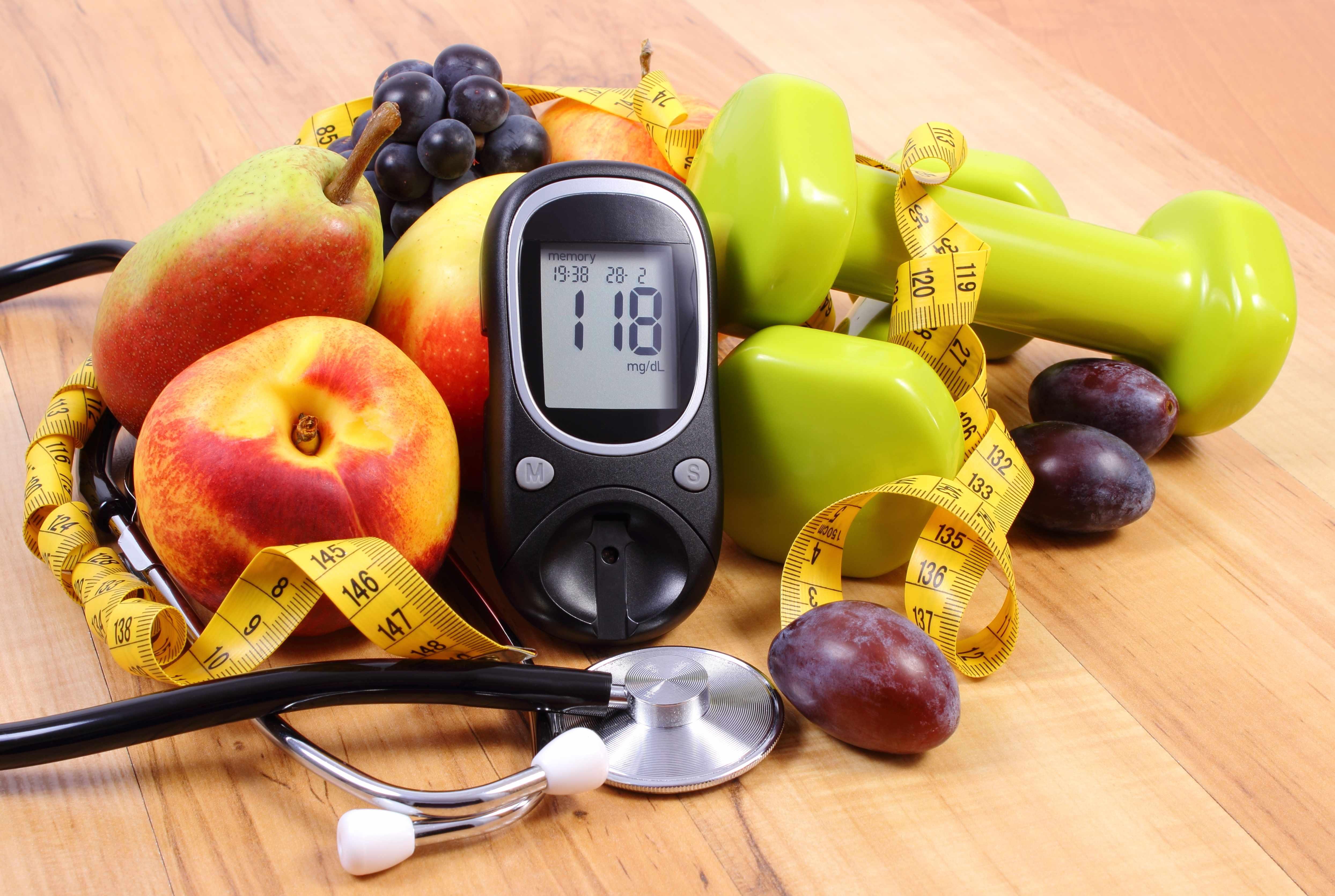 Fruit surrounding Blood Pressure Monitor Health