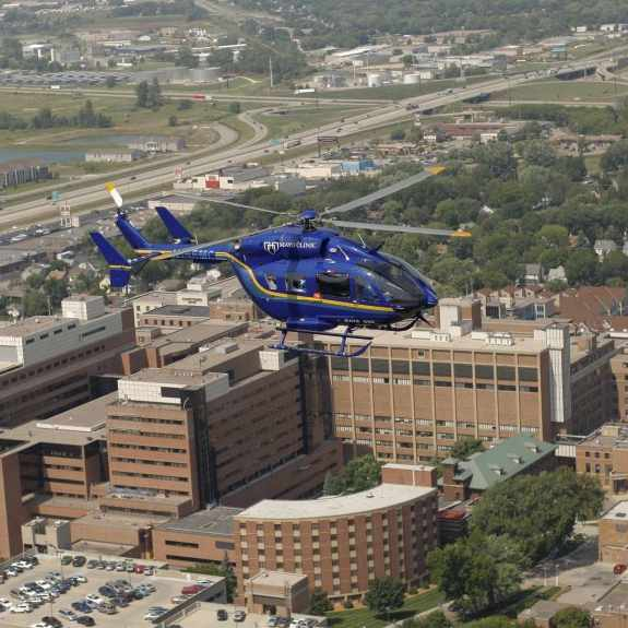 aerial image of Mayo One helicopter in flight over Saint Marys Hospital