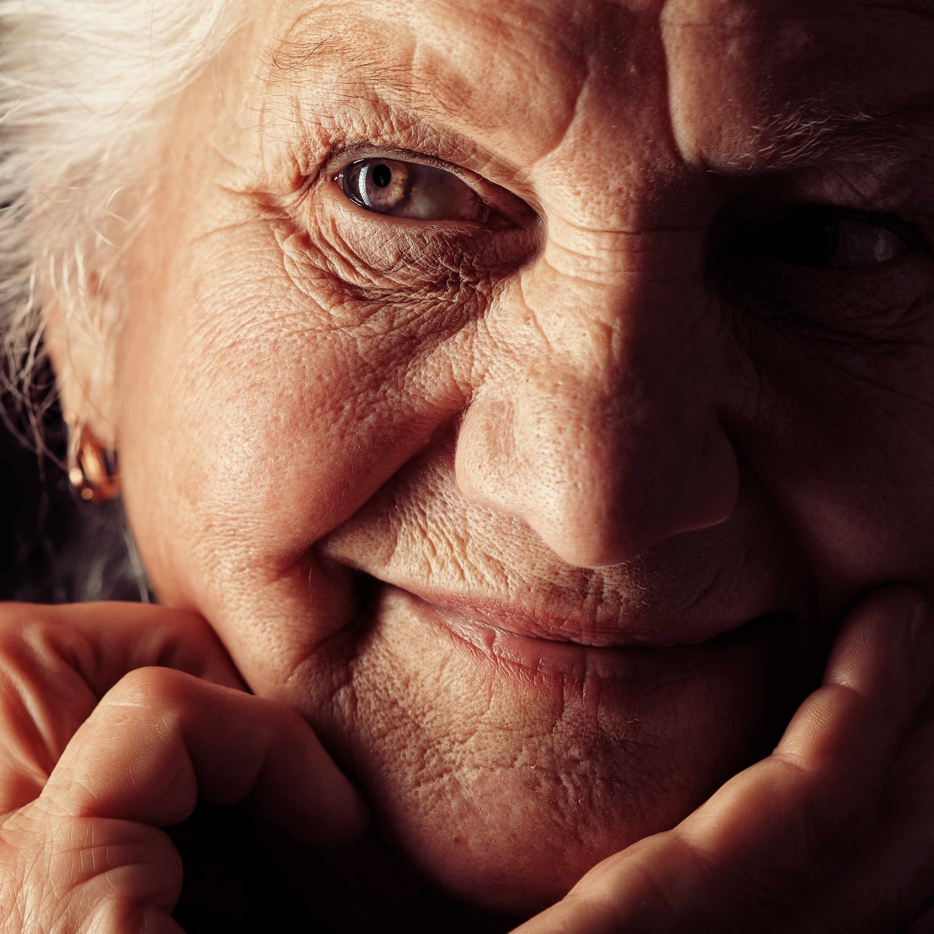 close up of elderly woman with gray hair