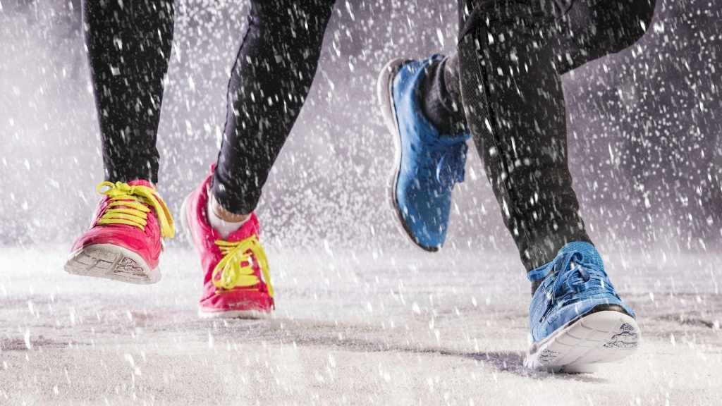 people running, jogging in winter snow and on icy path