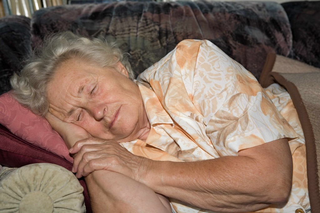older woman sleeping on couch
