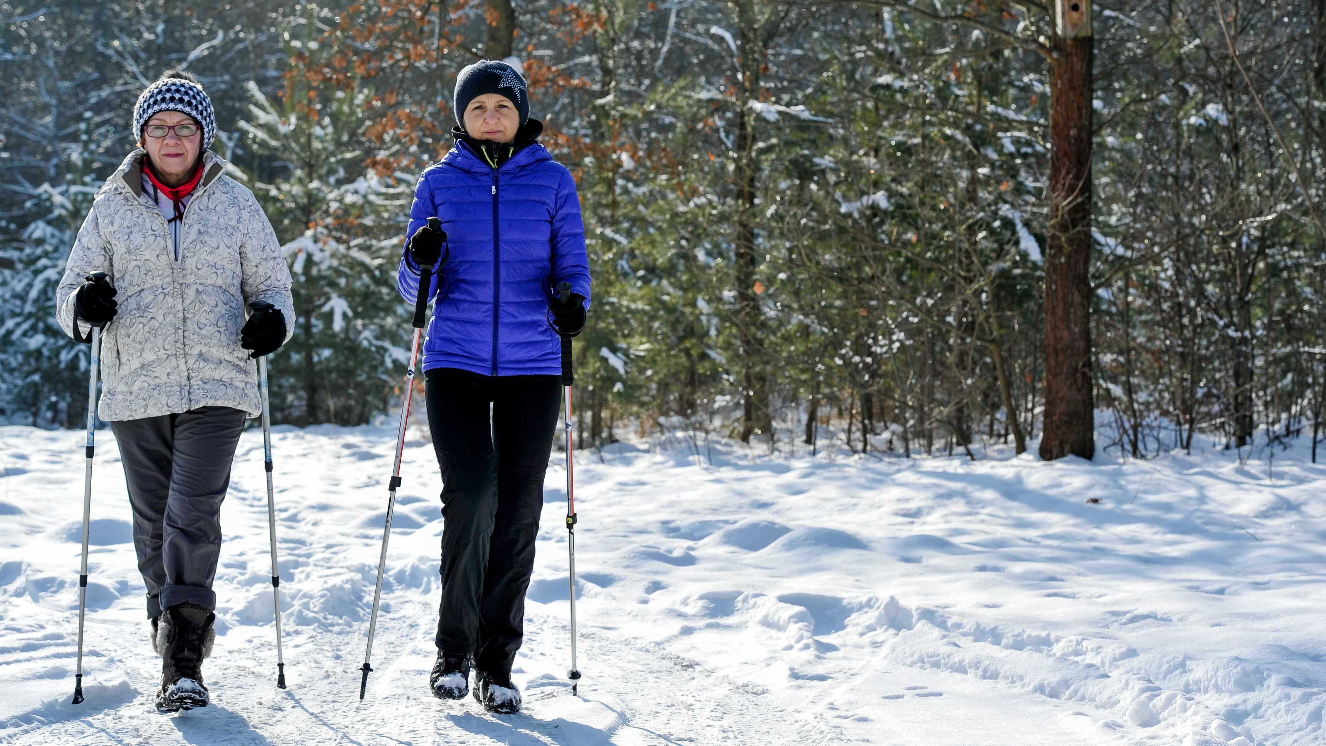 women cross-country skiing and exercising in the snow