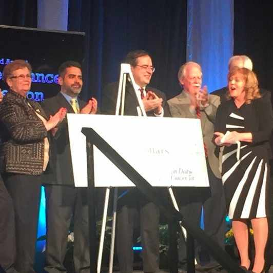 Dr. Robert Diasio, on stage with ceremonial check from the 2015 5th District Eagles Cancer Telethon.