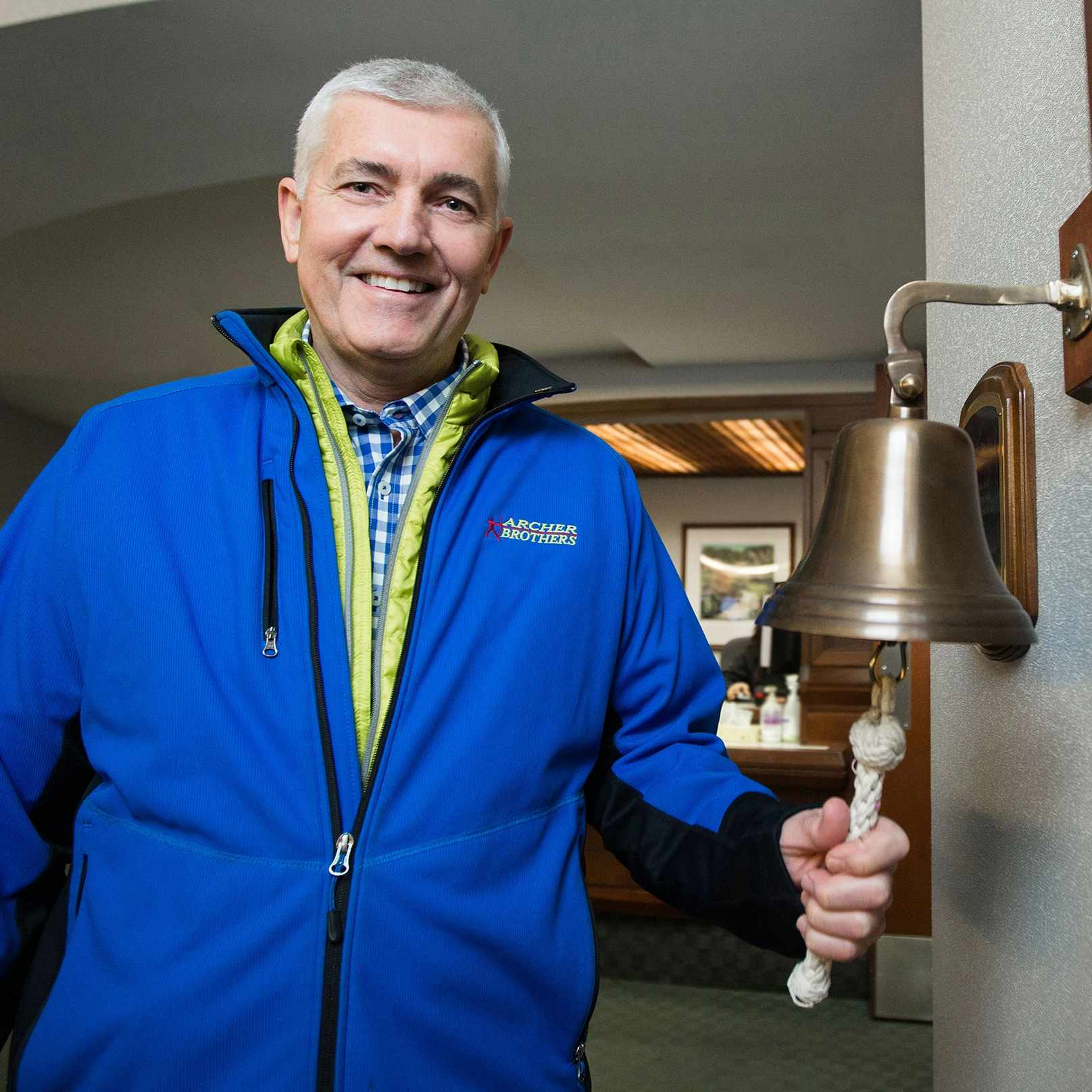 Tommy Archer ringing the bell to mark the end of radiation treatments.