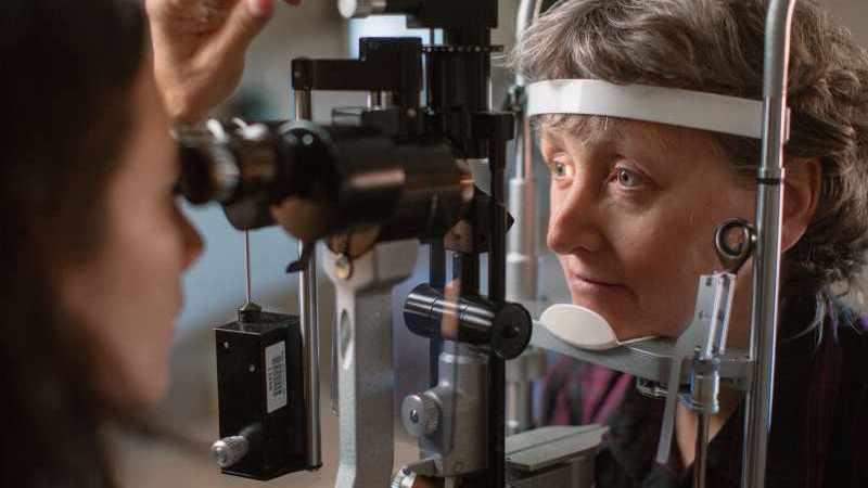 older woman having an eye exam, testing for glaucoma