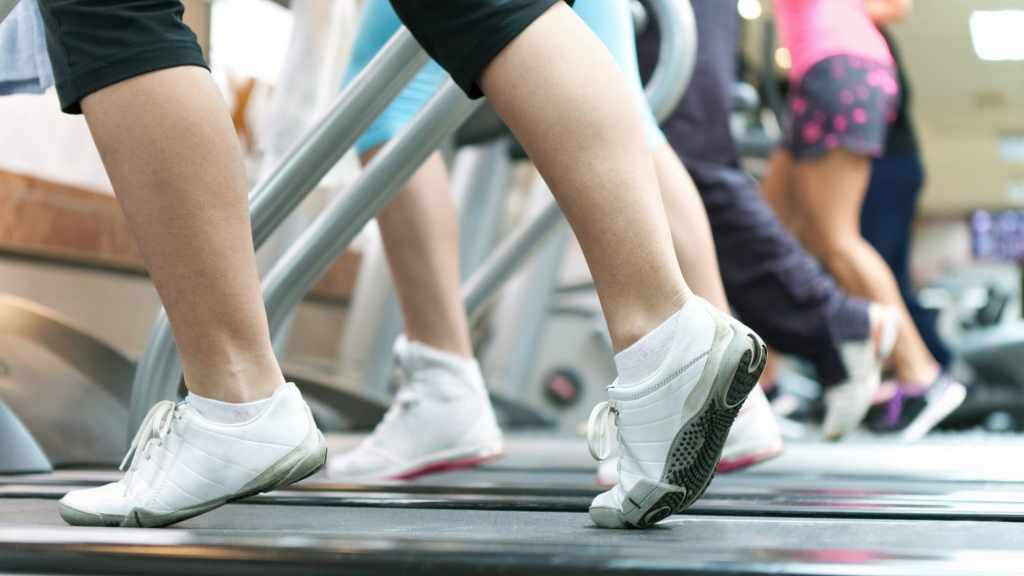 people exercising by walking, running on treadmills