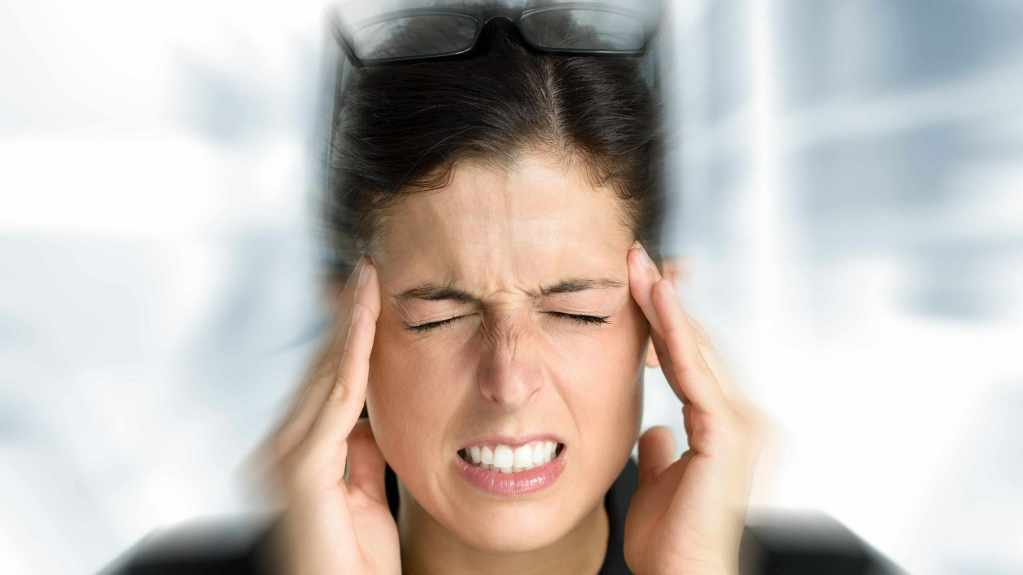 woman with a headache or migraine