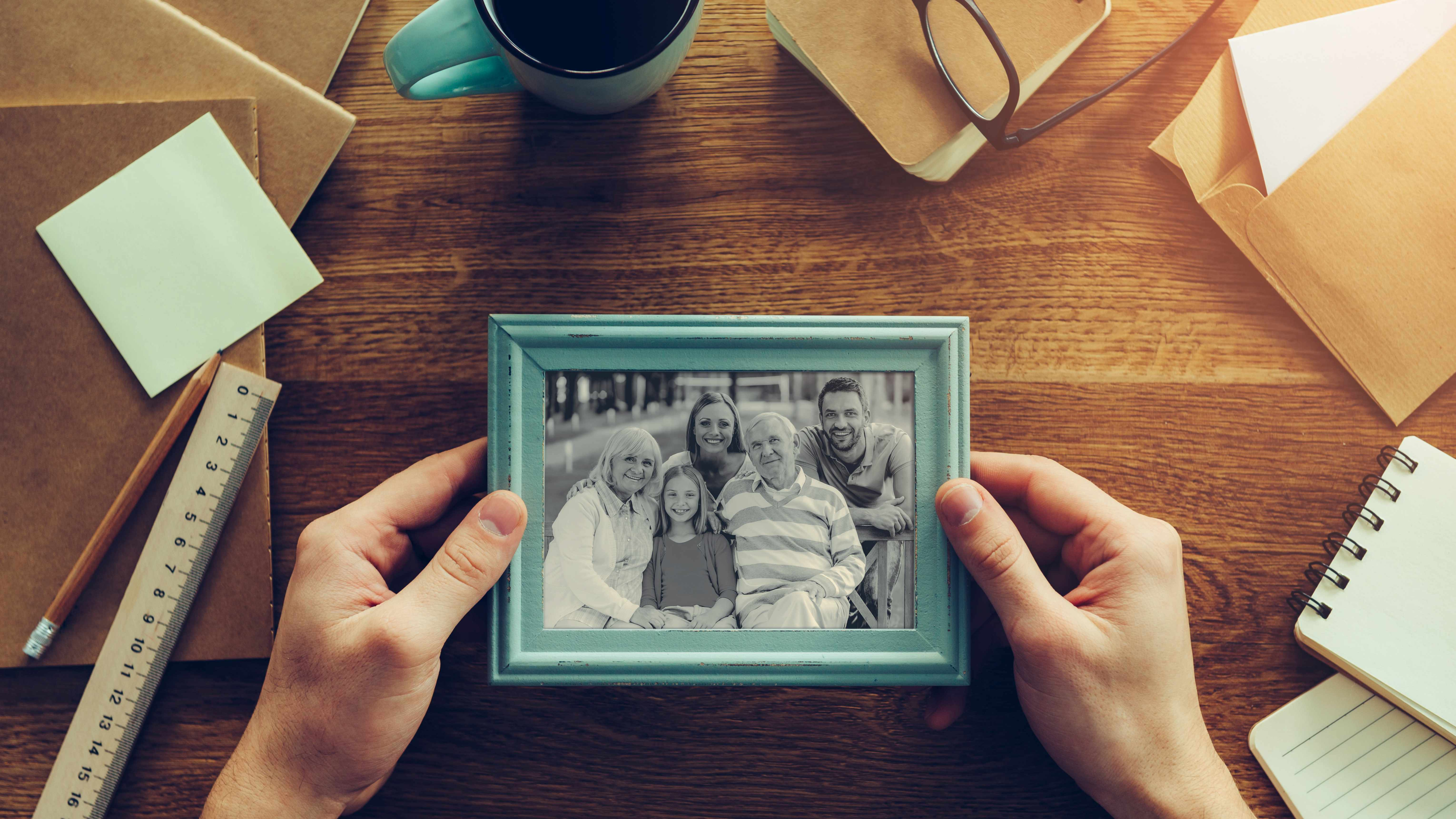 person with old photographs and memories