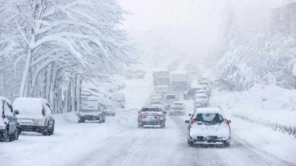 snowstorm, poor visibility,slick roads and lots of traffic