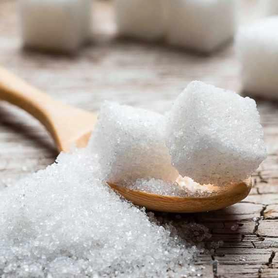 sugar cubes on a spoon