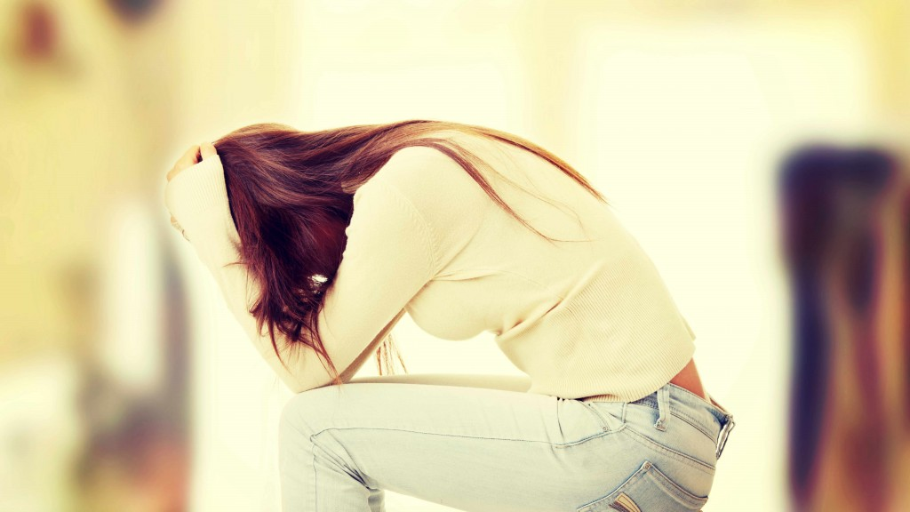 young woman with her head in her hands, sad, worried, anxious, depressed