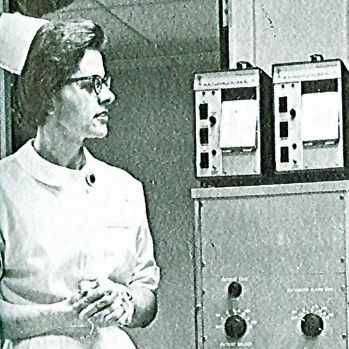 1965 Mayo Clinic nurse at St. Marys watching monitoring units being installed
