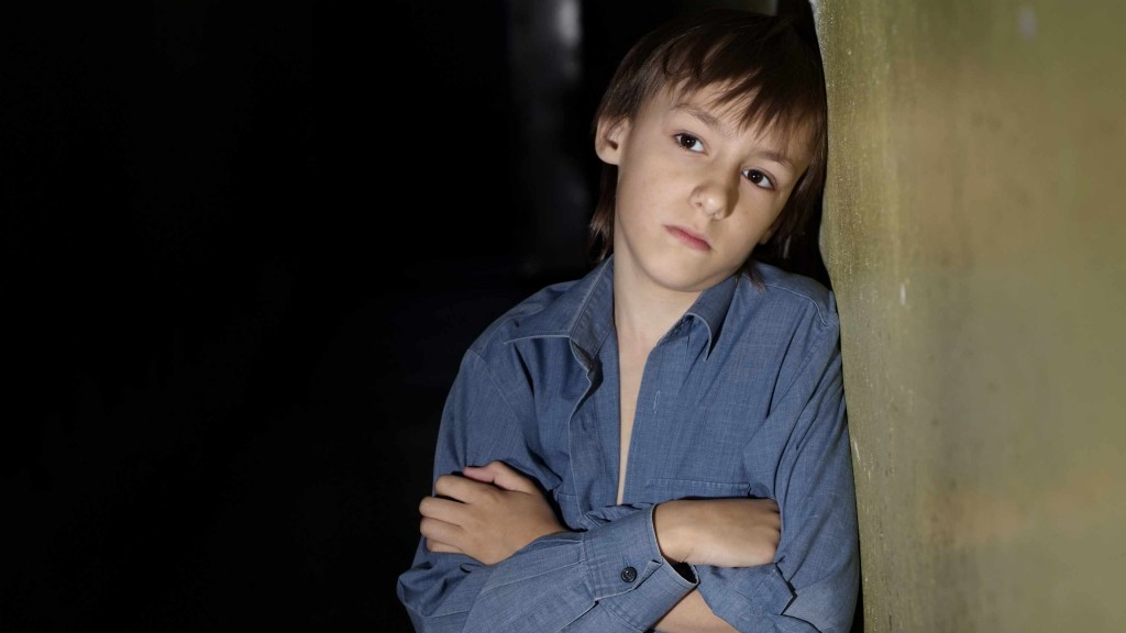 a teenager boy looking sad, depressed and alone