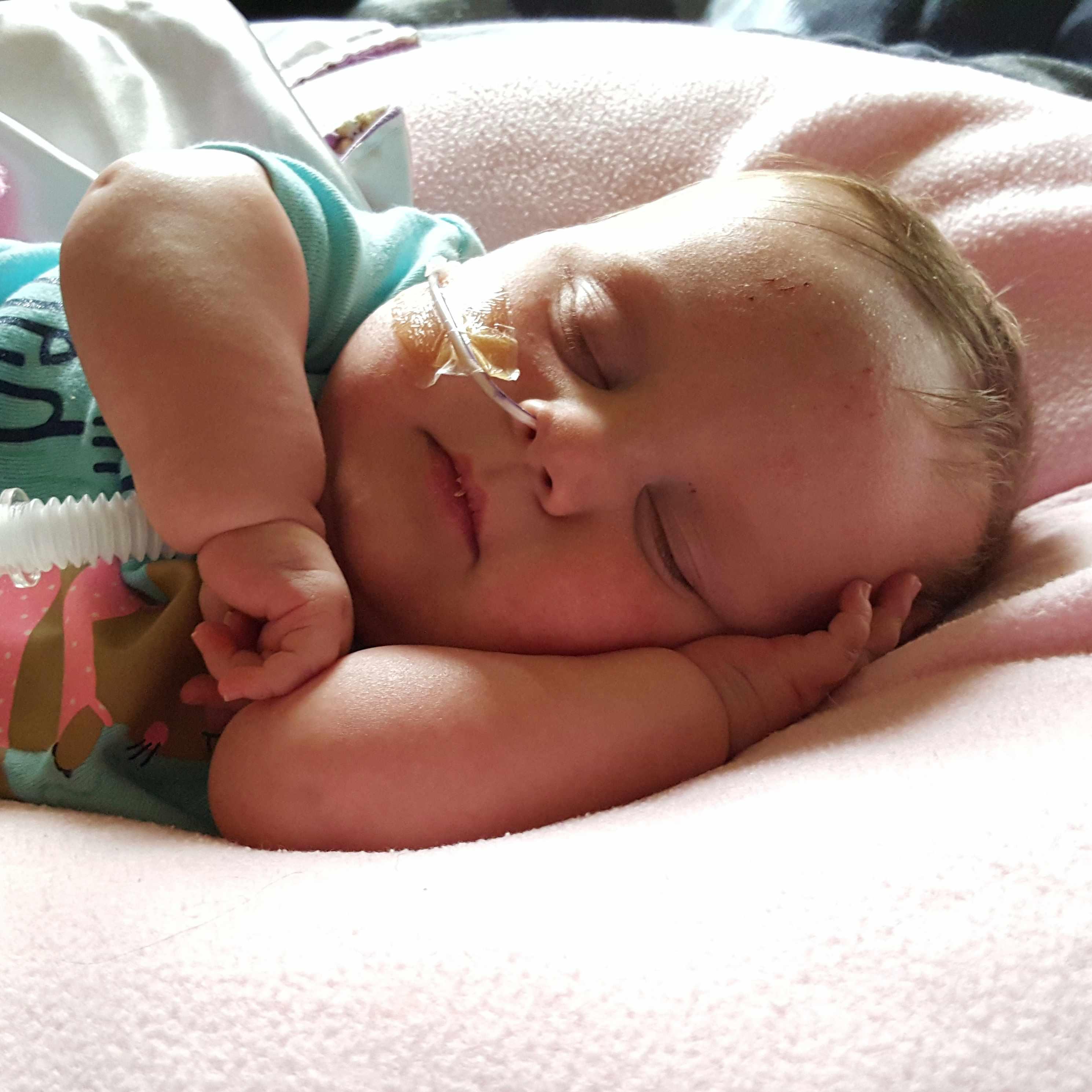 baby Kieran sleeping in hospital bed