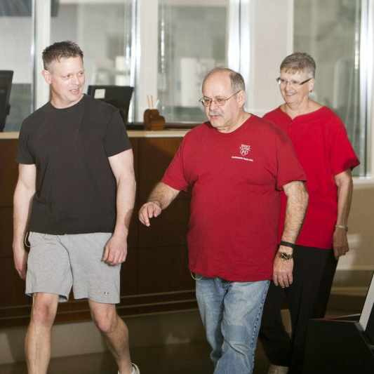 a cardiac patient exercising in rehabilitation center after heart surgery