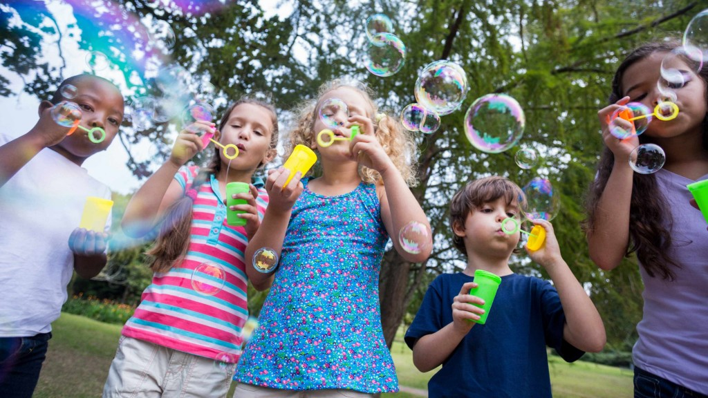 children with positive energy playing and having fun blowing bubbles