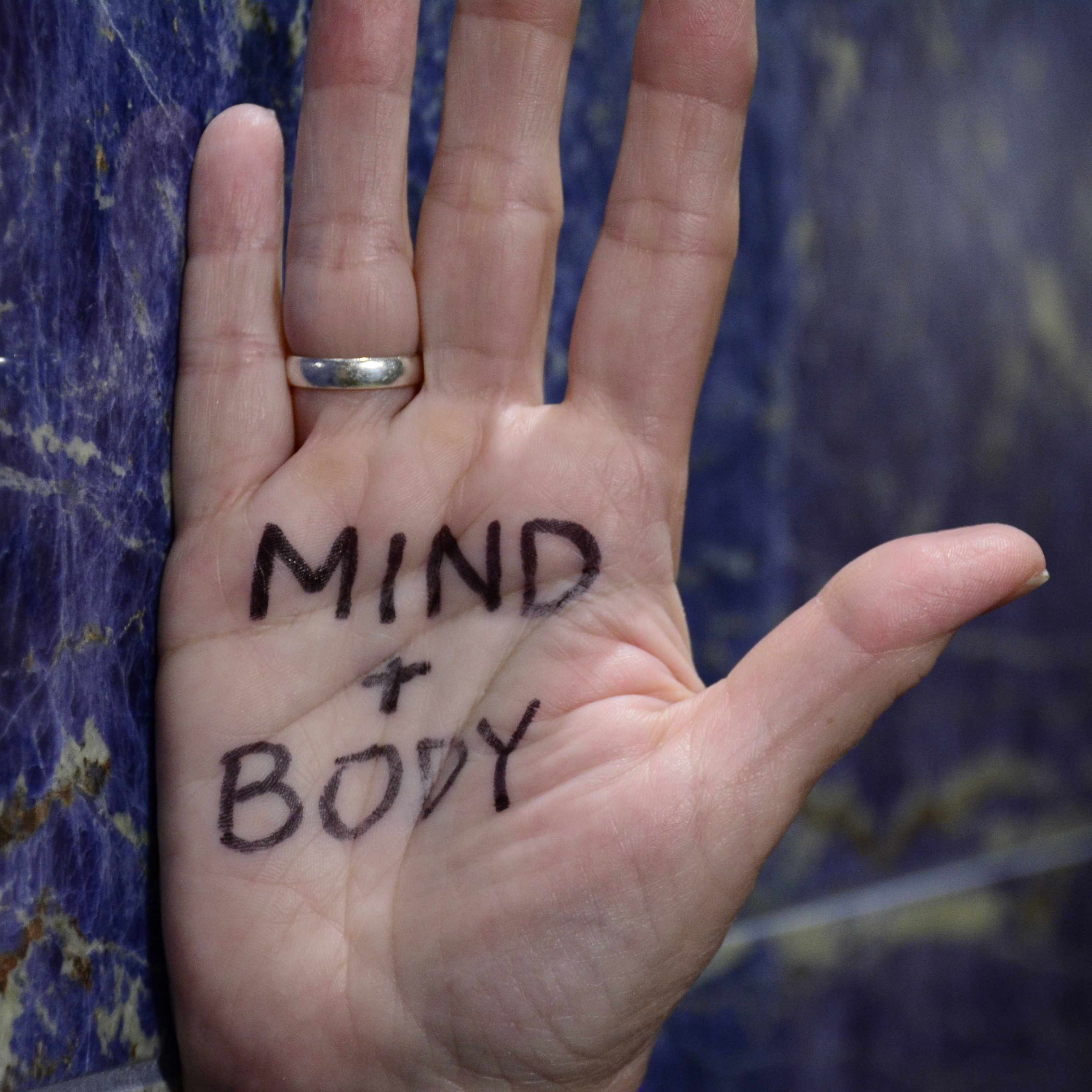 hand with writing that says mind and body for cancer day