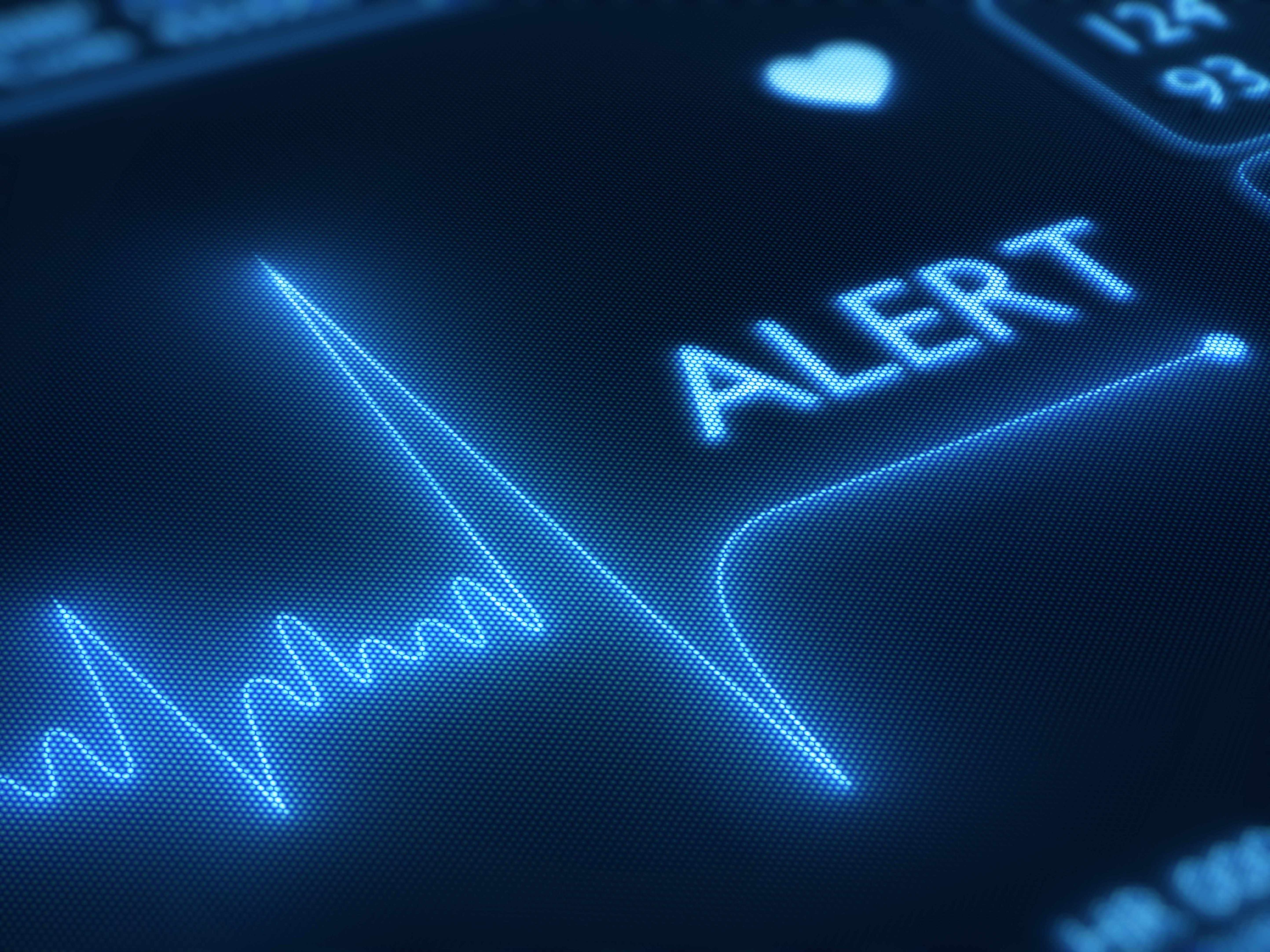 closeup of heart monitor with the text word alert