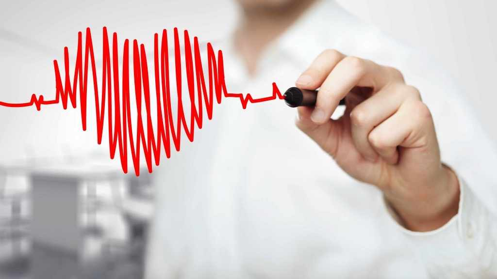 person drawing a heart and heartbeat