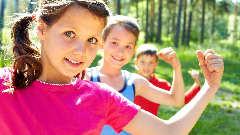 kids flexing their biceps