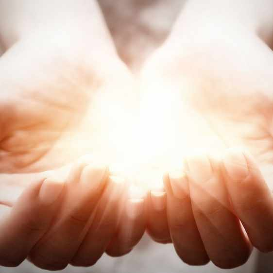 light in person's hands in cupped shape
