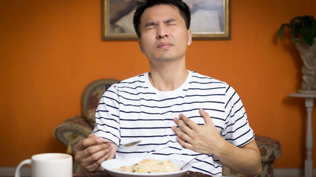 a man experiencing chest pain while eating food