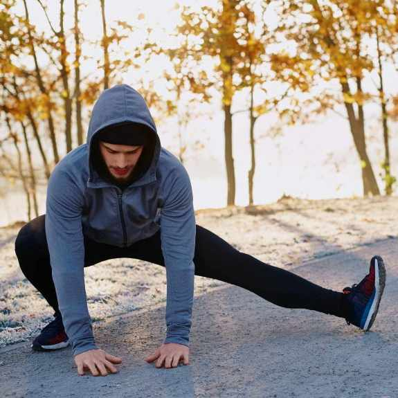 man stretching before exercising and running