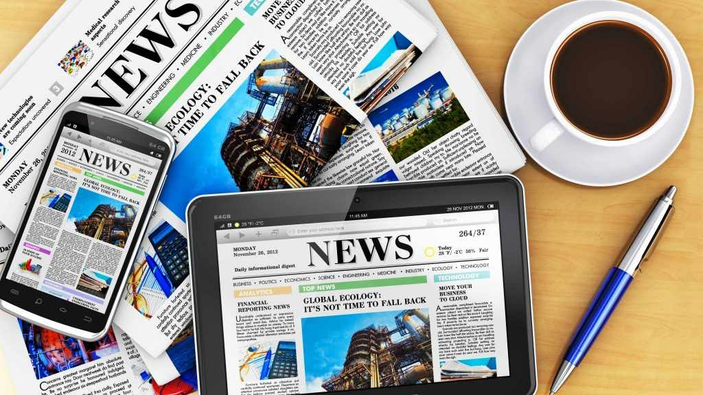 newspaper, phone and tablet displaying news