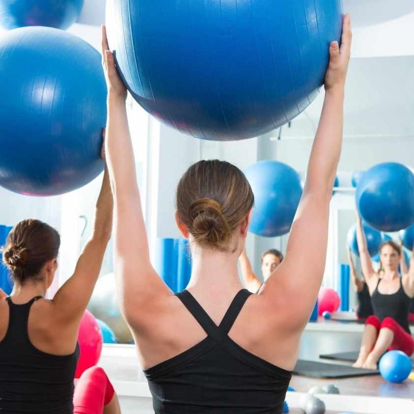 women using stability balls in a Pilates class
