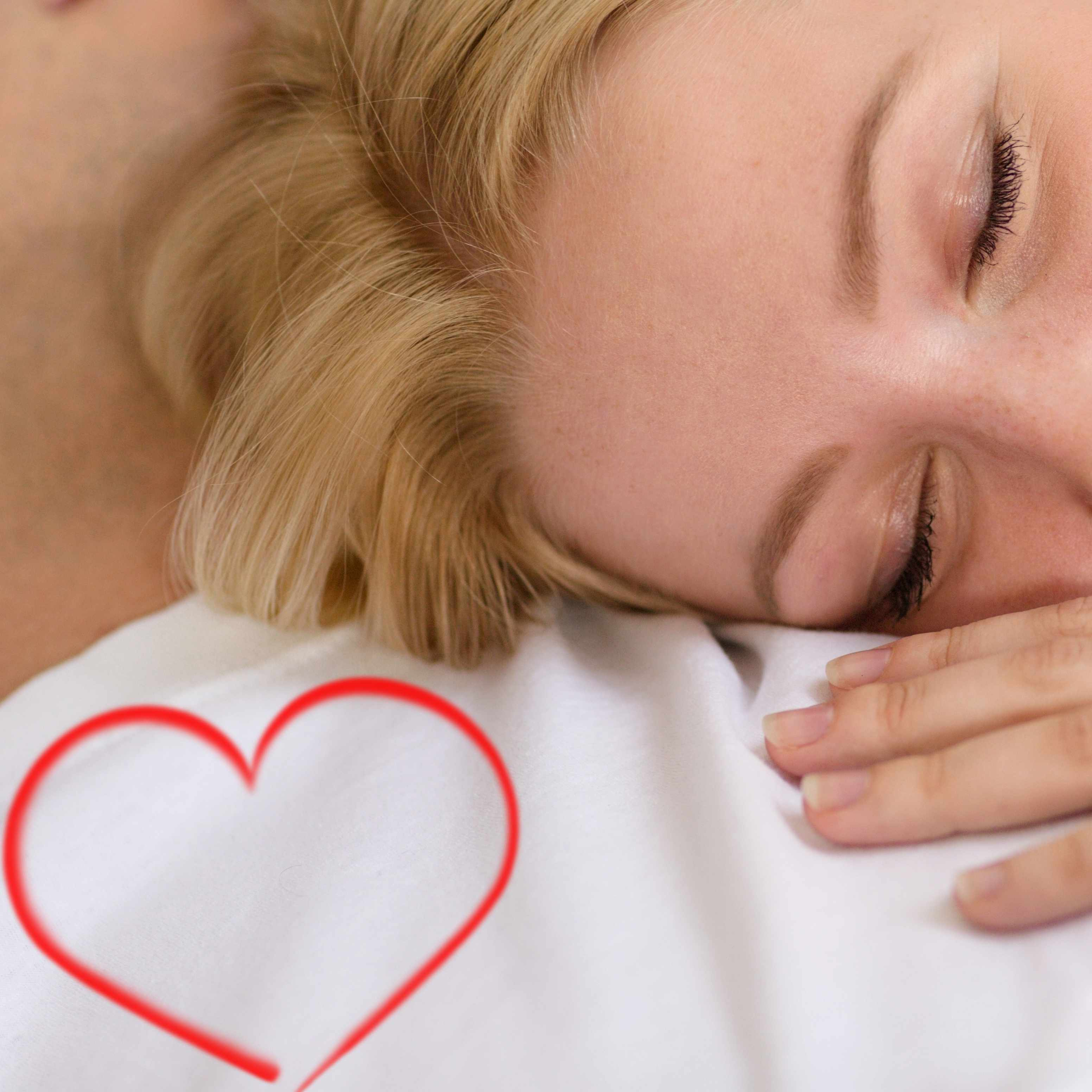 woman sleeping peacefully, loving sleep with a heart drawn in the corner