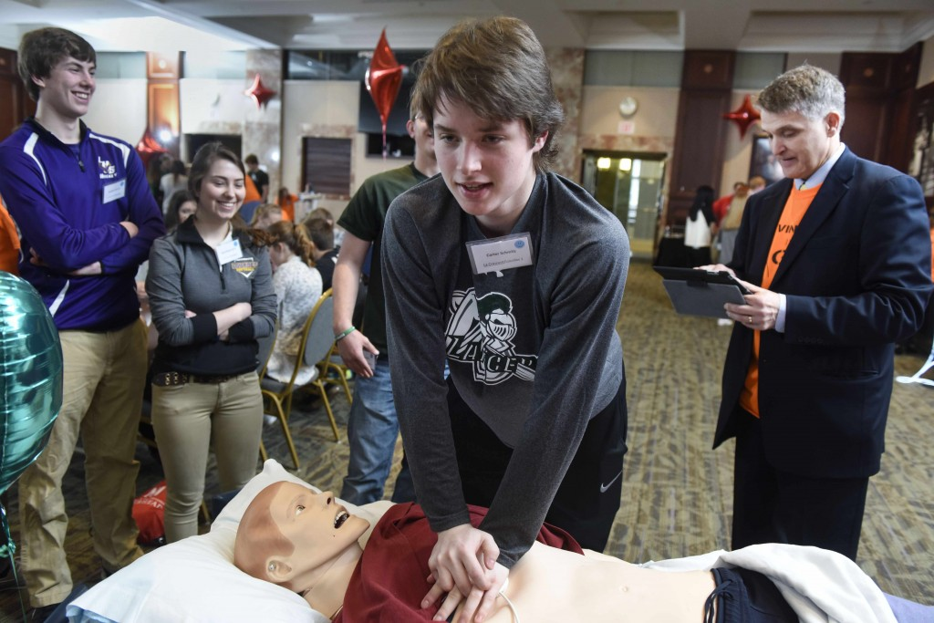 students doing CPR on the Gus mannequin